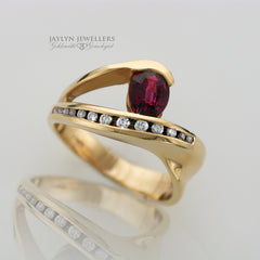 14K Sweeping Freeform Rhodolite Garnet and Diamond Ring by JayLyn Jewellers. $855.00
