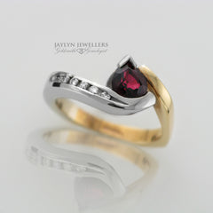 14K Two-Tone Freeform Pear-Cut Ruby and Diamond Ring by JayLyn Jewellers. $2490.00