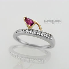 14K Two-Tone Freeform Pear-Cut Ruby and Diamond Ring by JayLyn Jewellers. $552.00