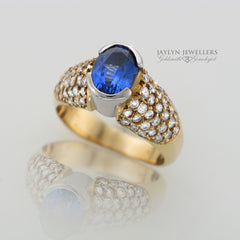 14K High Profile Sapphire and Diamond Dinner Ring by JayLyn Jewellers. $5136.00