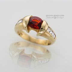 14K Modern Geometric Garnet and Diamond Ring by JayLyn Jewellers. $1800.00