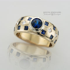 14K Geometric Sapphire and Diamond Band by JayLyn Jewellers. $3495.00