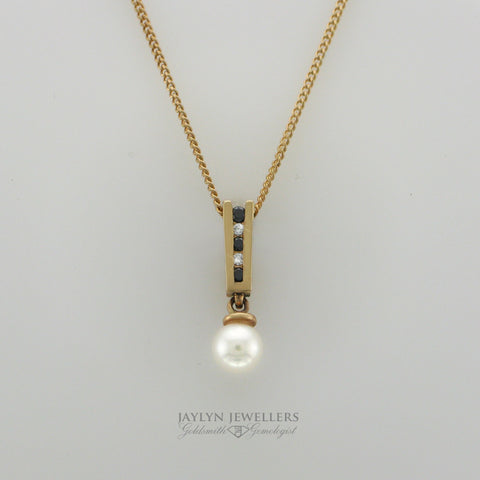14K Geometric Sapphire Diamond and Pearl Drop Pendant by JayLyn Jewellers. $295.00