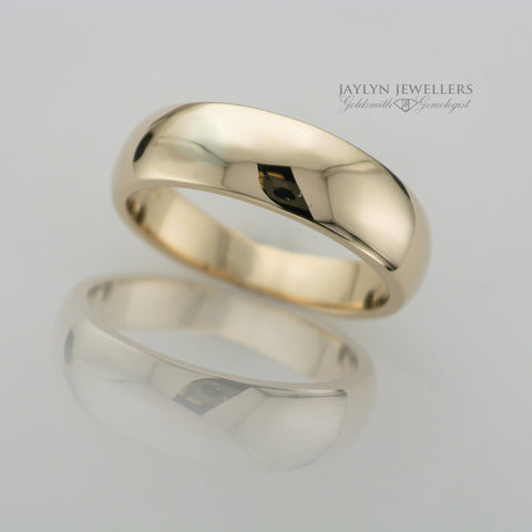 14K Yellow Gold 9mm Half-Round Tapered Wedding Band by JayLyn Jewellers. $474.99