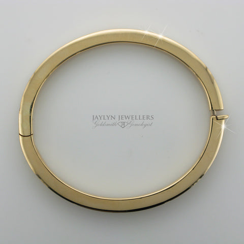 14K Yellow Gold Contemporary Oval Bangle by JayLyn Jewellers. $843.95