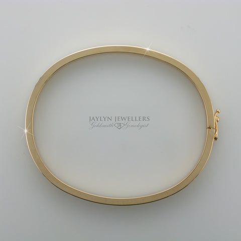 14K Yellow Gold Contemporary Oval Bangle by JayLyn Jewellers. $688.95