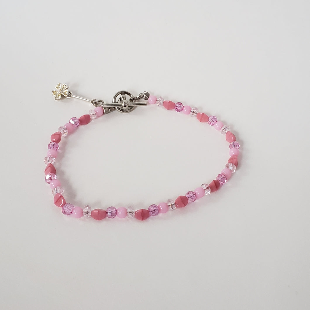 Pink Bracelet with Flower Charm