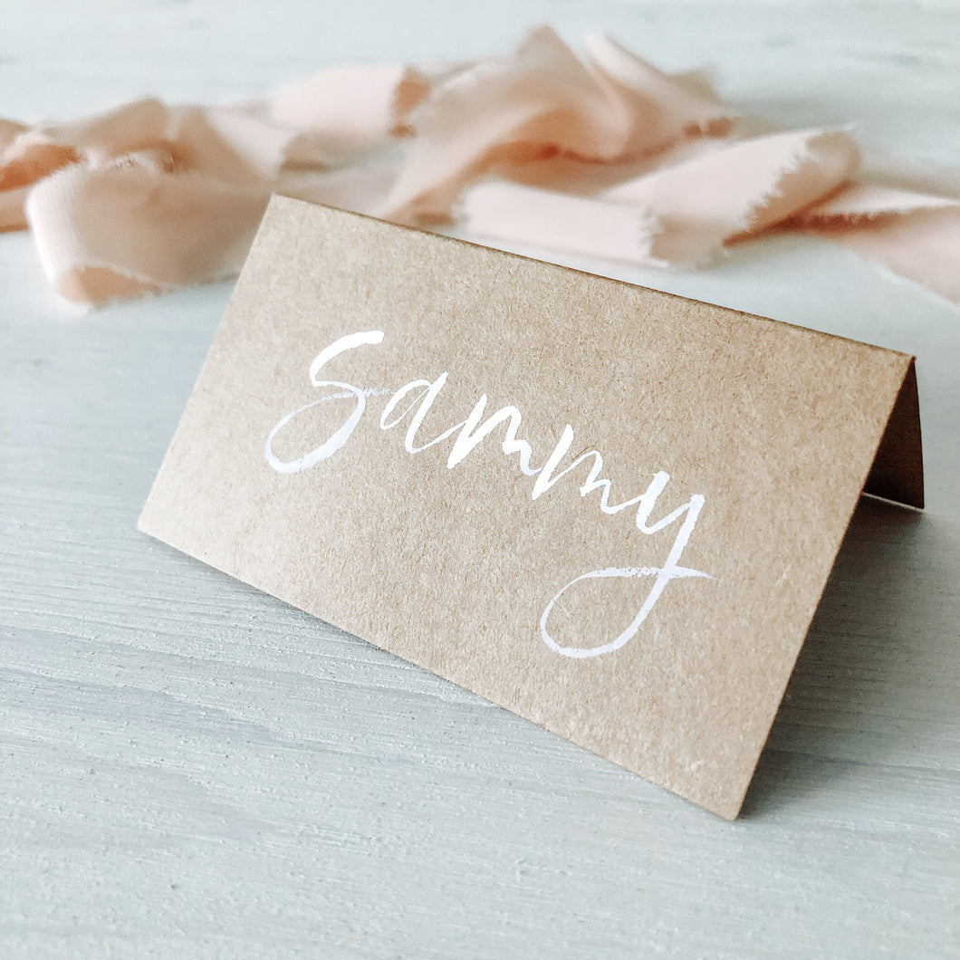 Escort or place card | Brush lettering on kraft tent