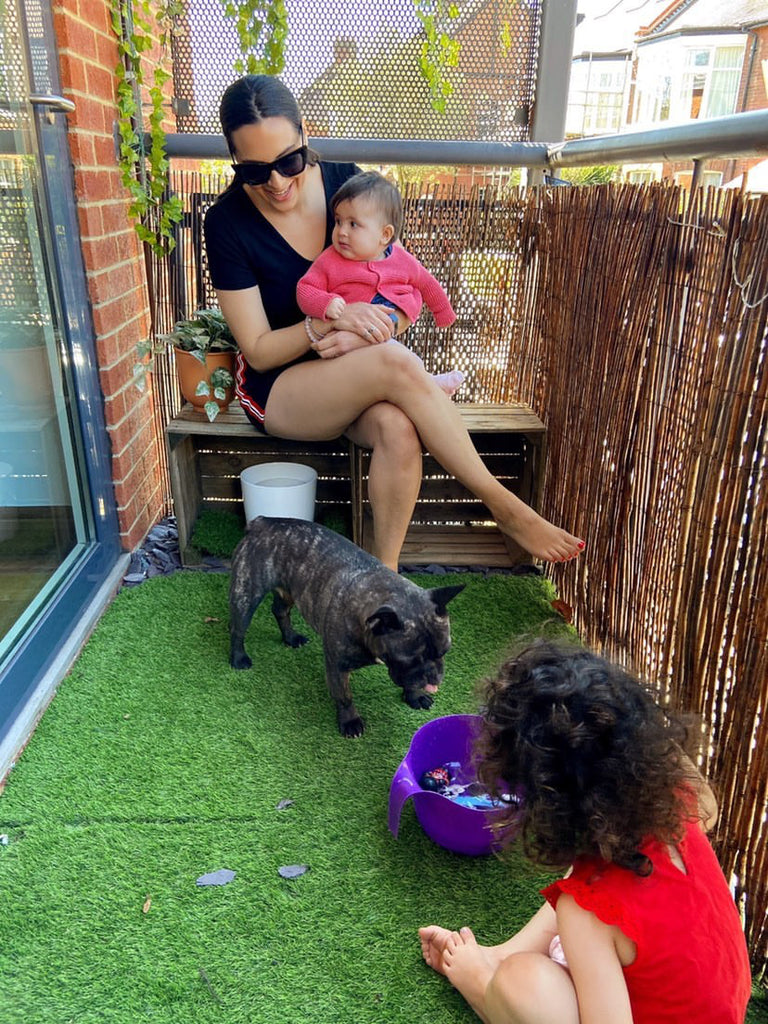 sophia from pooches and prams with kids and dogs on balcony in london