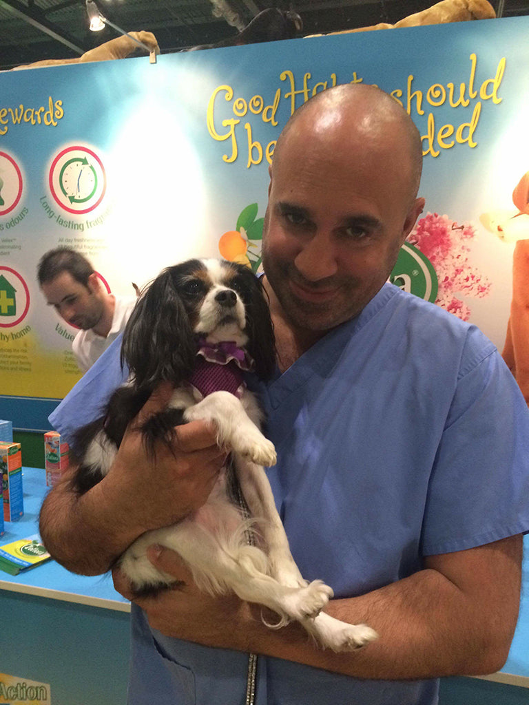 Vet Marc Abraham with dog Lucy