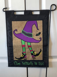 The Witch is in garden flag!