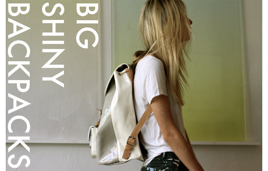 Le Corb gray and white cream leather patent backpack.