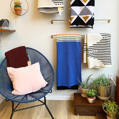 shop items displayed on the wall and on a chair