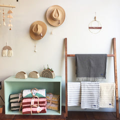 shop display of hats and blankets
