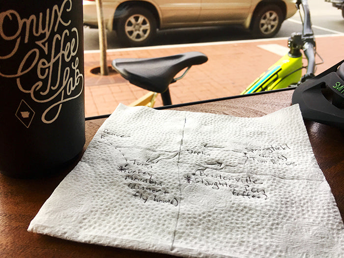 Planning the route for a full day of riding while enjoying the experience at Onyx Coffee Lab