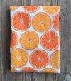 flour sack tea towel . oranges
