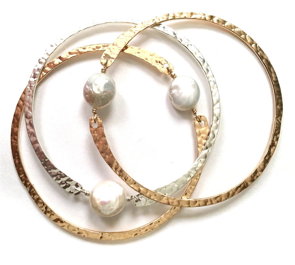 bangle . white coin pearl
