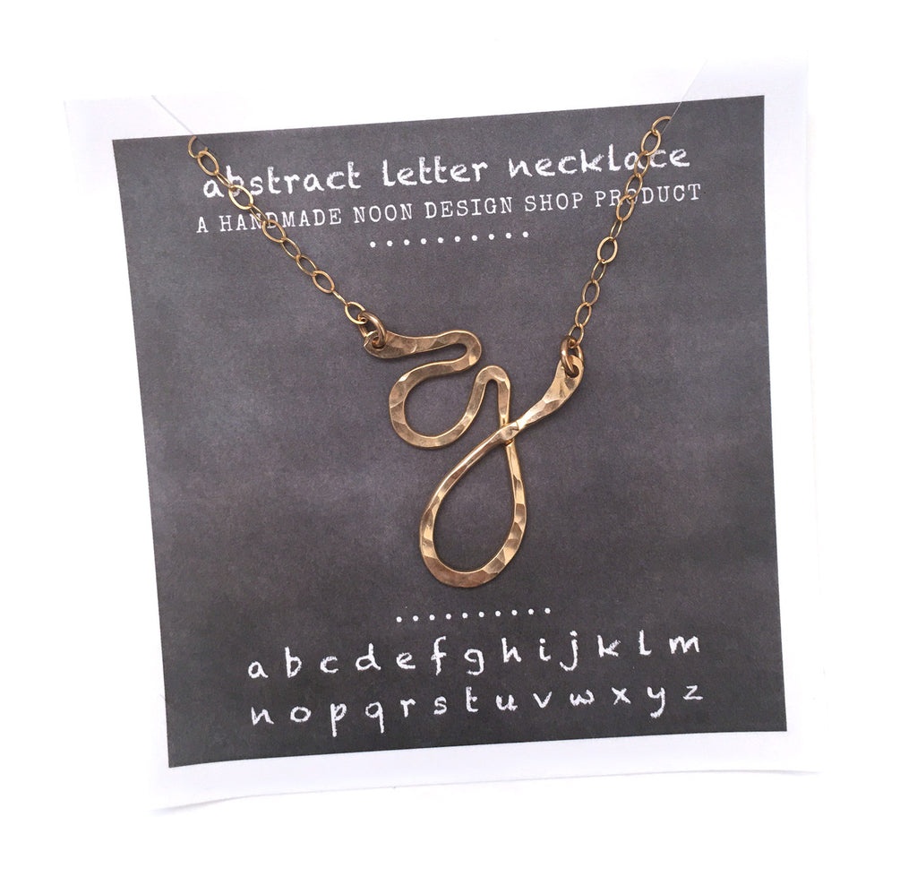 necklace . abstract letters