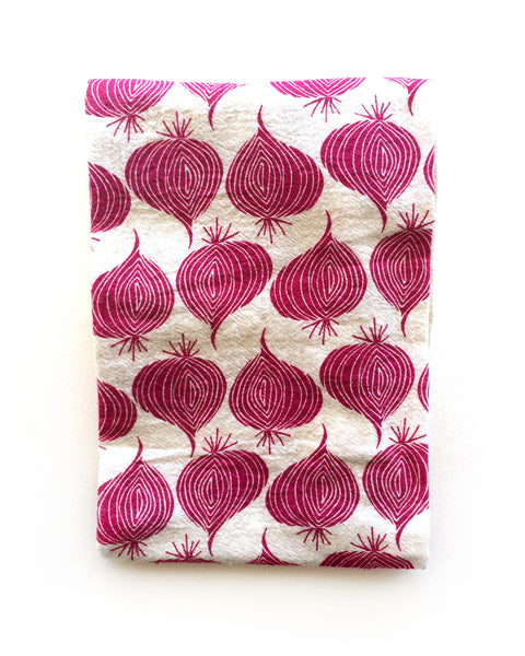 flour sack tea towel . red onions