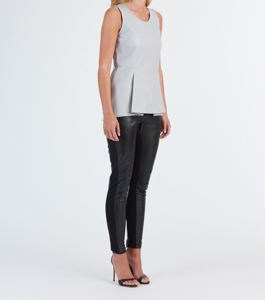 Structure leather peplum top available in black and grey. 100% authentic leather