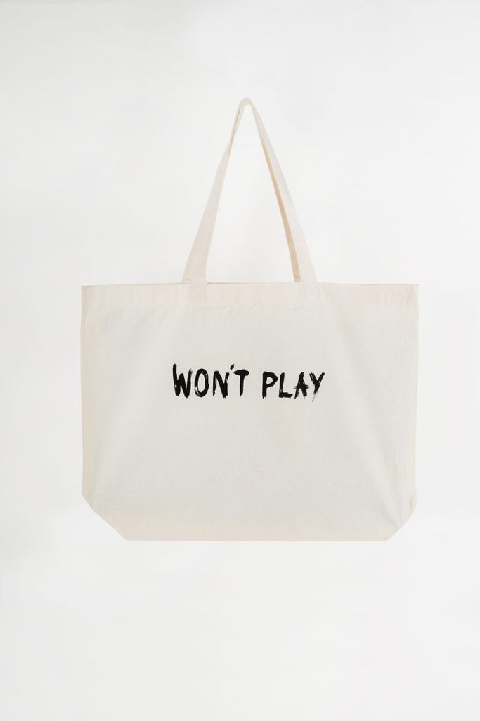 "White canvas tote bag with a black ""WON'T PLAY"" logo"