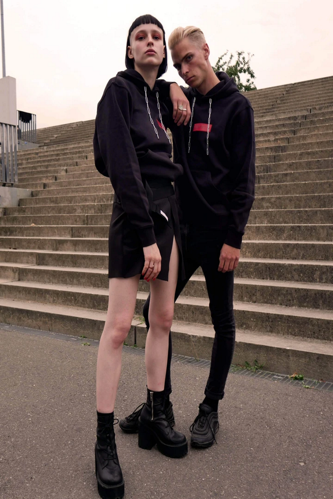 A man and a woman wearing NAKT brand clothes