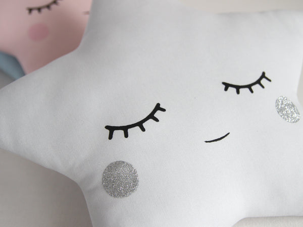 light gray star pillow with a silver cheeks, baby cushion