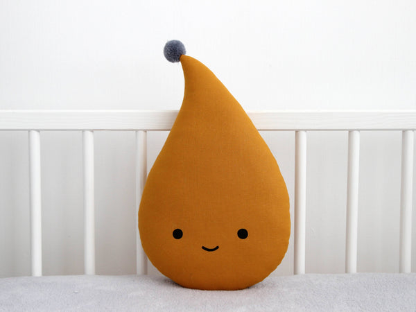 Smiling mustard raindrop cushion