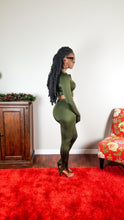 Load image into Gallery viewer, Olive green matching set. Long sleeve (lower in the front and slightly curved on the sides) top with a black front zipper featuring thumb holes/inserts and a mock neck collar when zipped up.  Paired with matching high waist bottoms with adjustable outer ankle zippers. Great stretch.