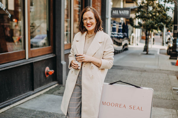Moorea Seal in front of her downtown Seattle store