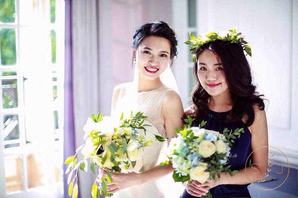 Chinese Bride wearing a Peony Rice Lace Silk Wedding Gown for wedding photo with maid of honour