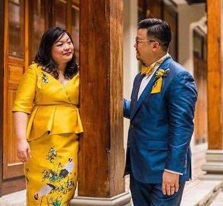 Bride in a Yellow Peony Rice custom made oriental dress and groom in blue suit in Penang malaysia