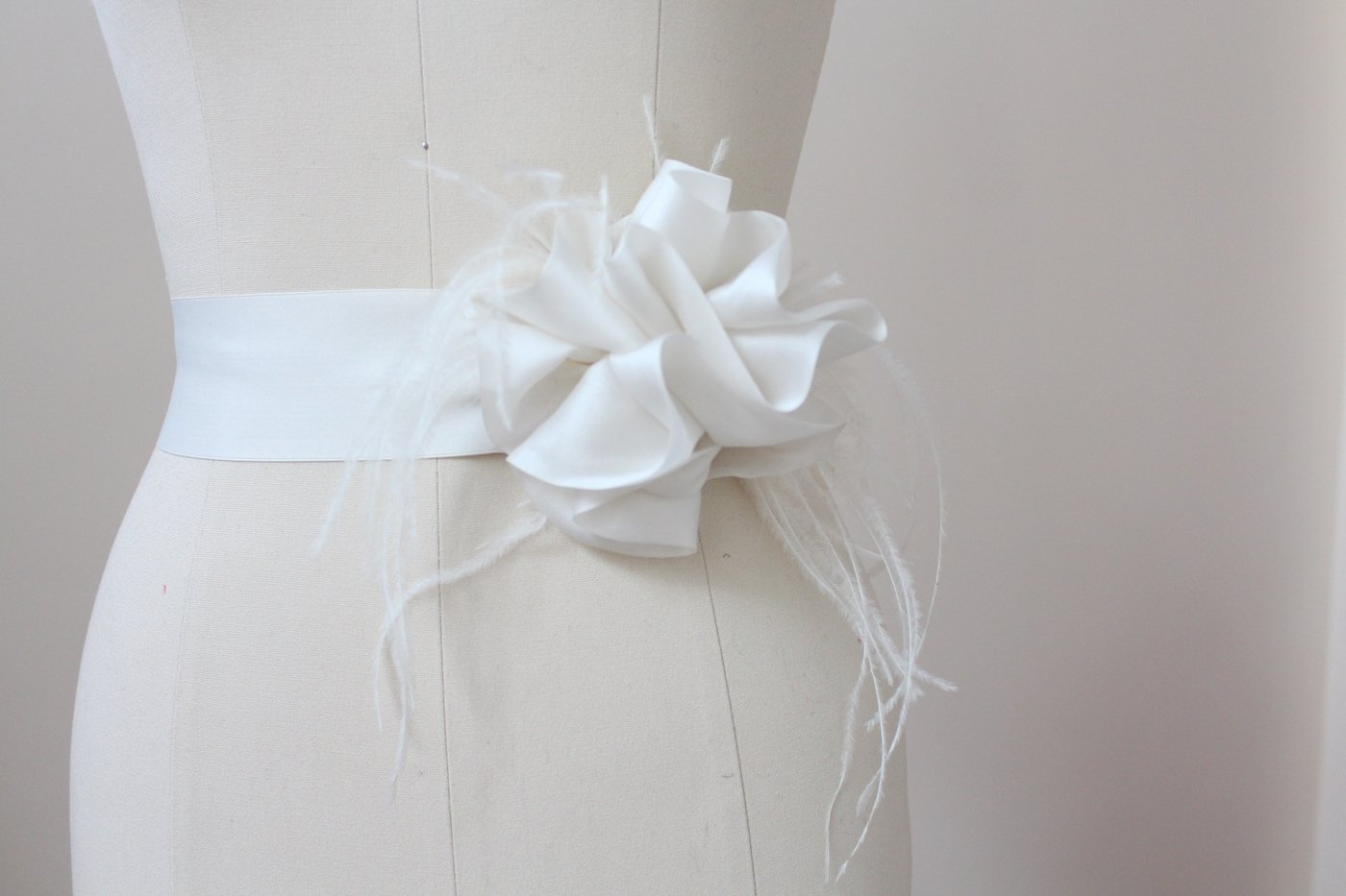 Style: MARILYN Feather Trimmed Silk Satin Organza Swirl Sash Belt - Peony Rice