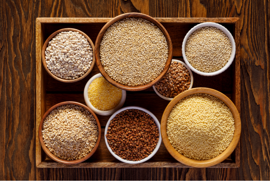 Different types of millets set in a tray in bowls.