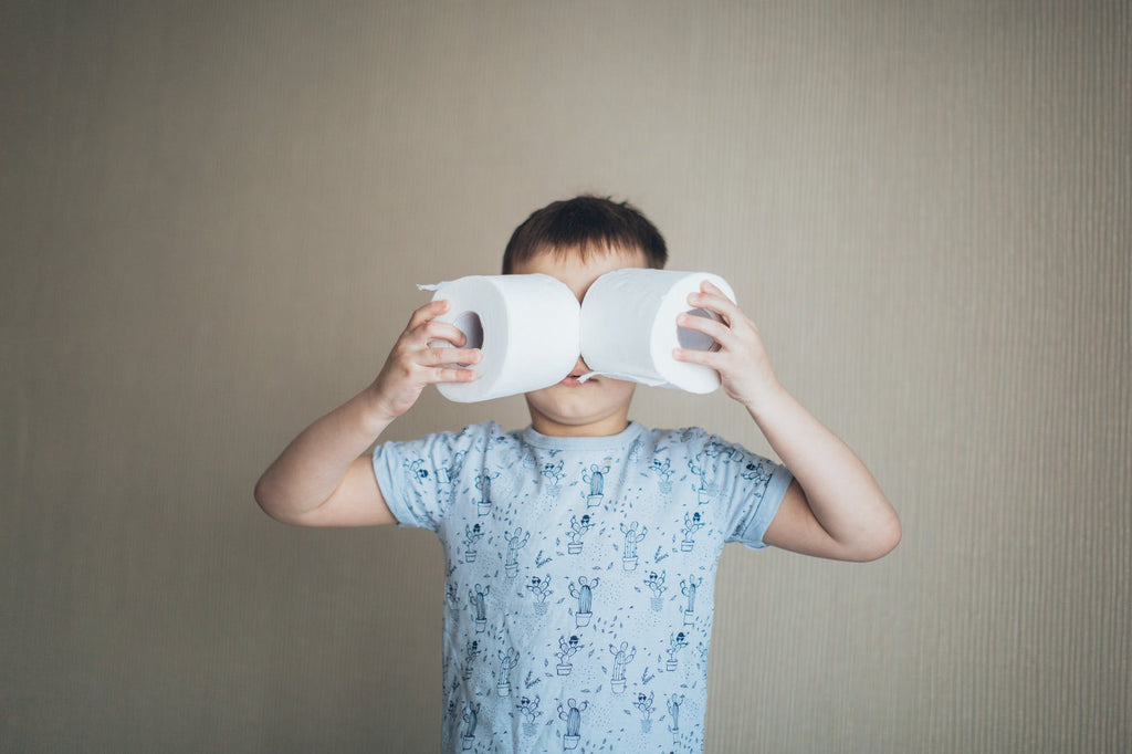 Treat Loose Motions In Children - Boy holding toilet rolls