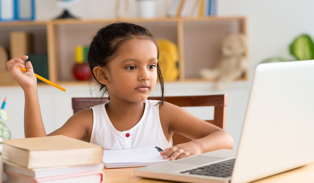 Child sitting in front of the laptop