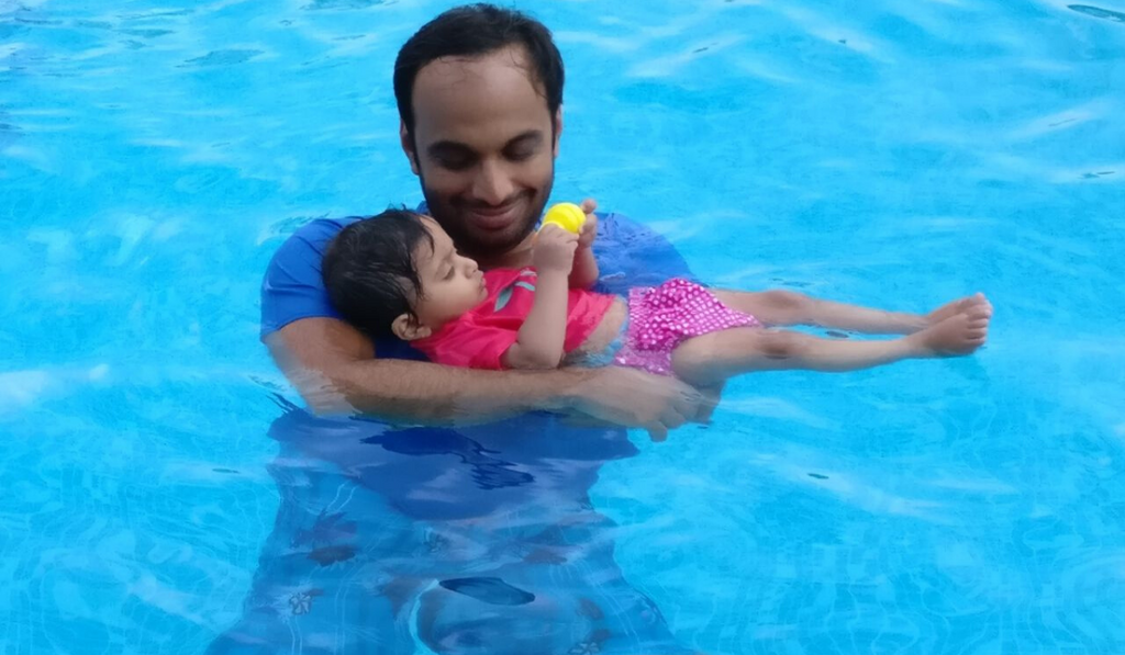 """Faster, Higher And Stronger"" - Says Hakimuddin Habibulla. A father carrying his little daughter in a swimming pool."