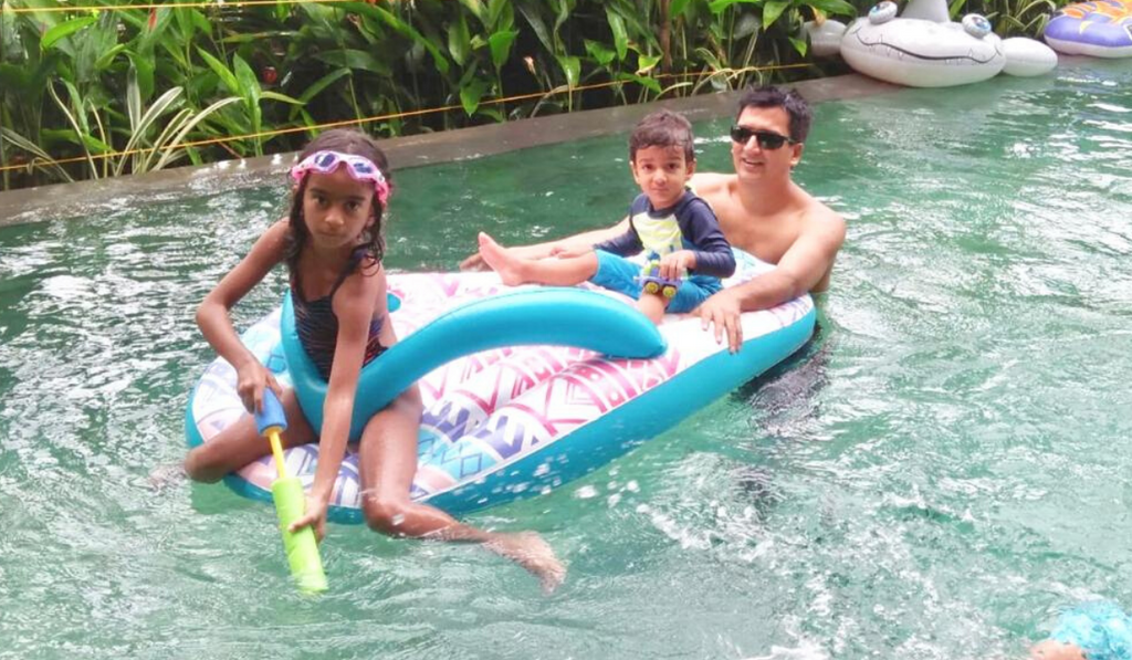 Celebrating Father's Day With Superdad Dr. Shravan Subramanyam. Father in a swimming pool with his two children.
