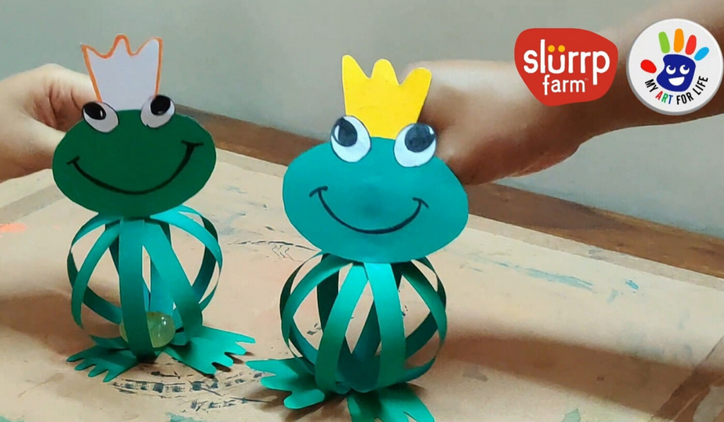 Bouncy Frog - Easy Paper Crafts for Kids during Monsoon. Two paper frogs smiling.