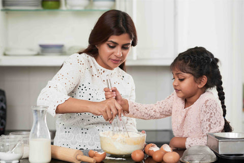 Positive Parenting tips - A girl helping her mother in the kitchen
