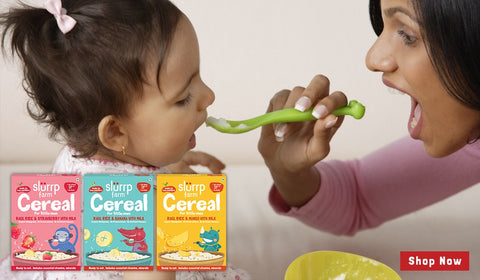 A mother feeding baby - When And How Do I Get My Baby Started On Solid Foods
