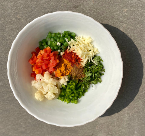 Add the masala to the chopped vegetables