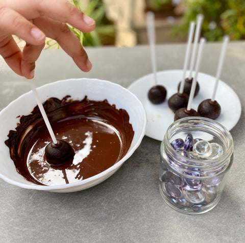 Put the balls in chocolate syrup