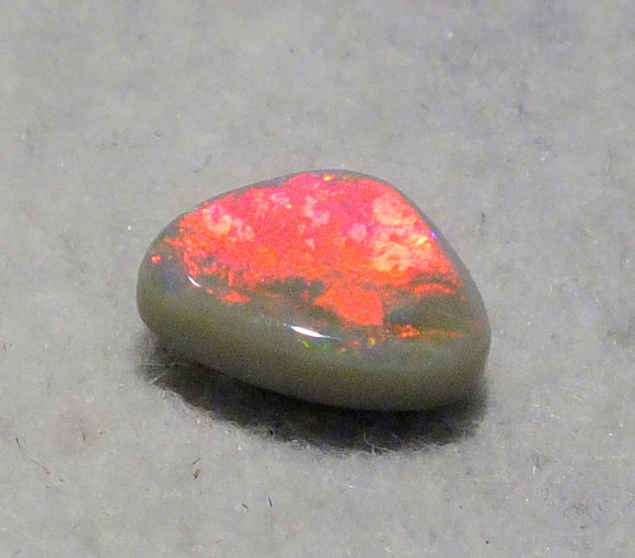 Red Australian opal on grey potch from Cloud Publishing