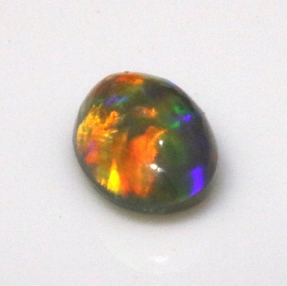 red green blue dark Australian opal gemstone from Cloud Publishing