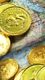 Gold coins on map in continent of Africa