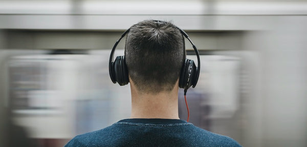 a man wearing noise canceling headphones