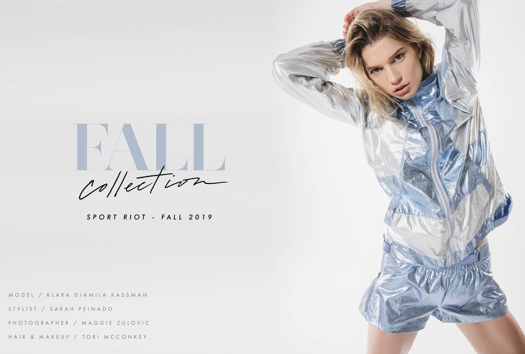 2019 Fall Active and Apparel main image. Model is wearing Zip Up Metallic Jacket in light blue and Metallic shorts in light blue.
