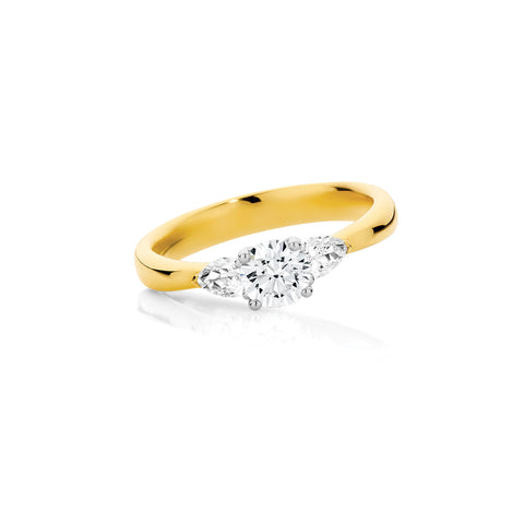 Round Brilliant and Pear Cut Diamond Trilogy Ring