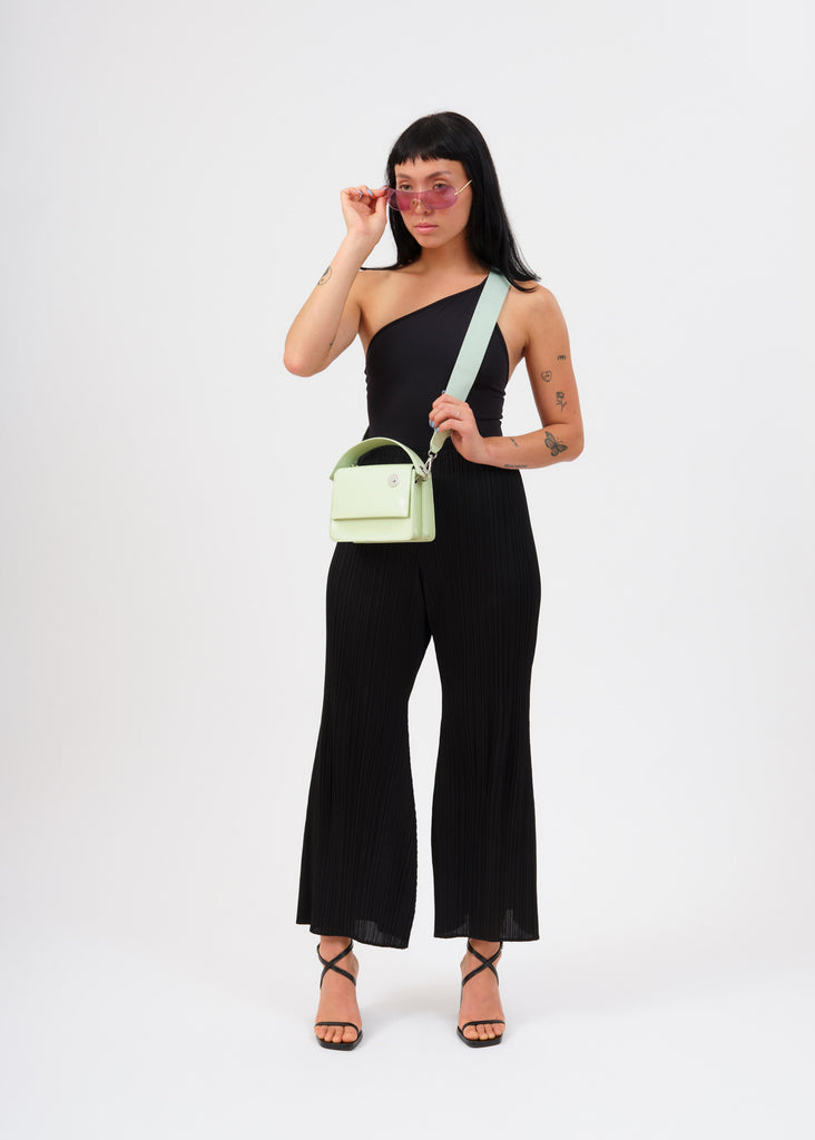 Model wearing mint baby pinch shoulder bag with sunglasses